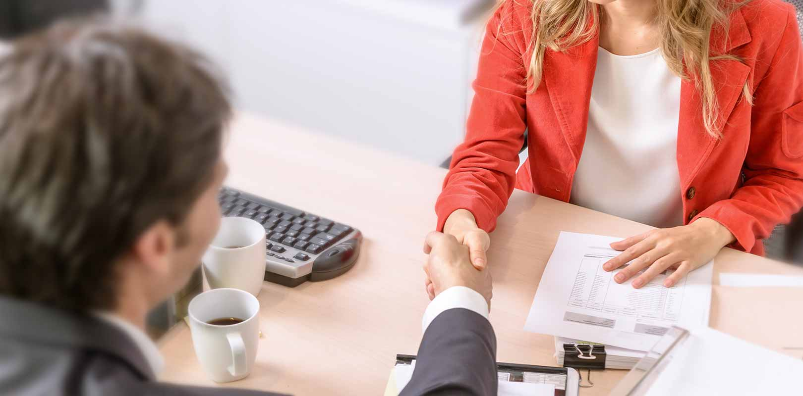 Sales woman agreeing a design contract with client
