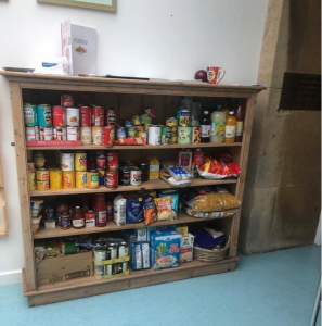 Tinned foods on shelf, at a local foodbank