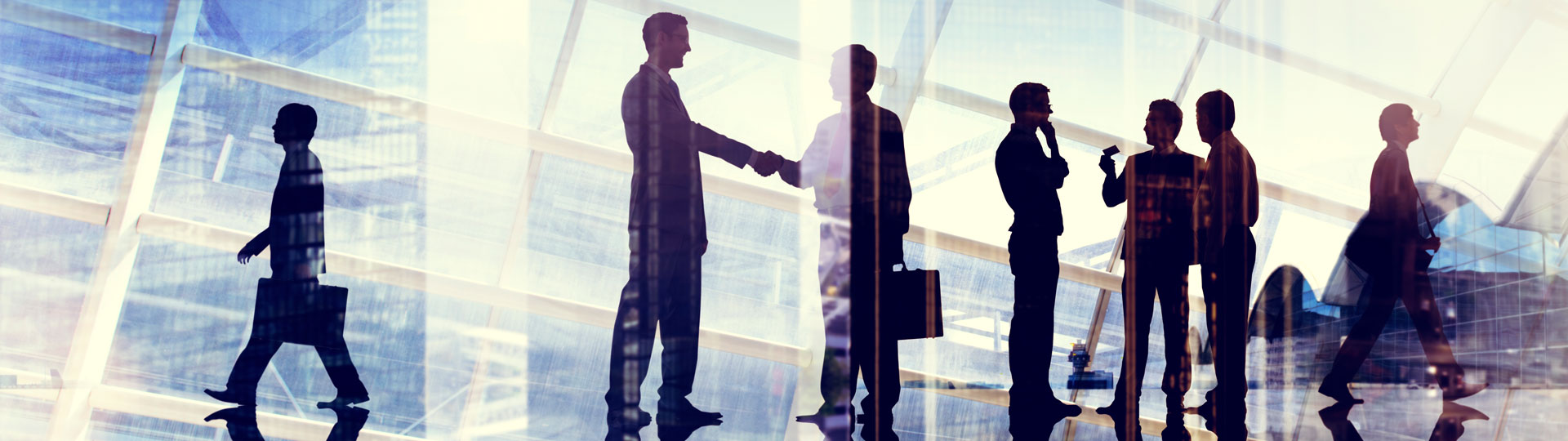 Clients shaking hands in an insurance brokers office