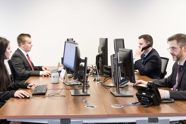 Brunel employees working at a large shared desk