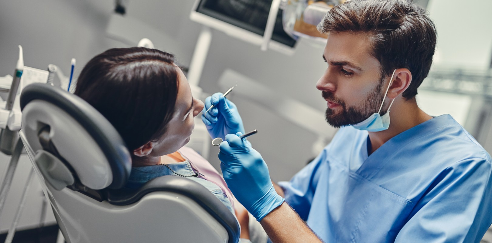 Dentist performing on patient