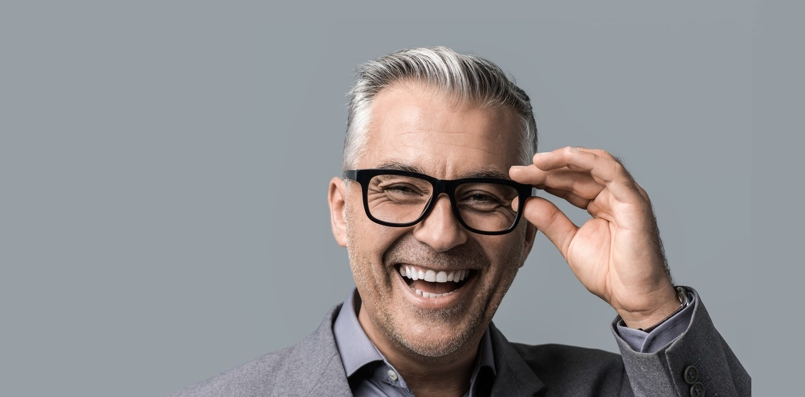 Middle aged man with glasses laughing
